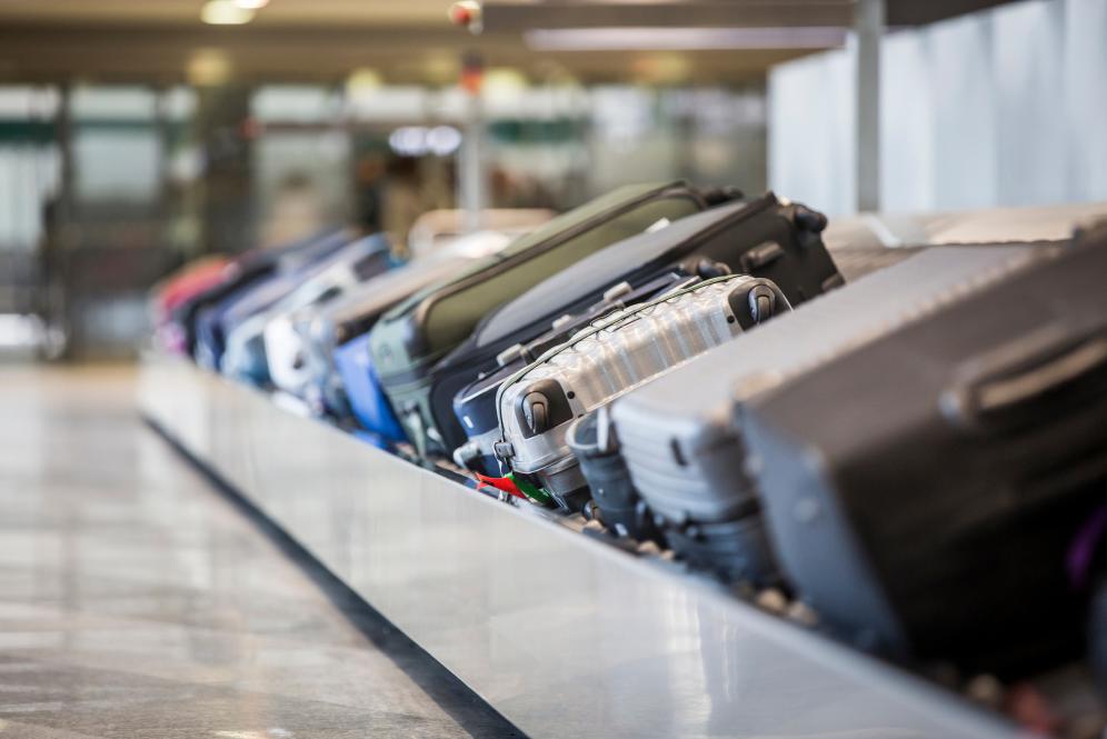 Photo of luggage on a luggage belt